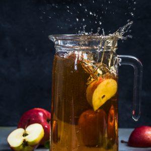 Apple juice splash with apple piece